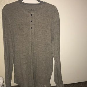 warm long sleeve with buttons down the front